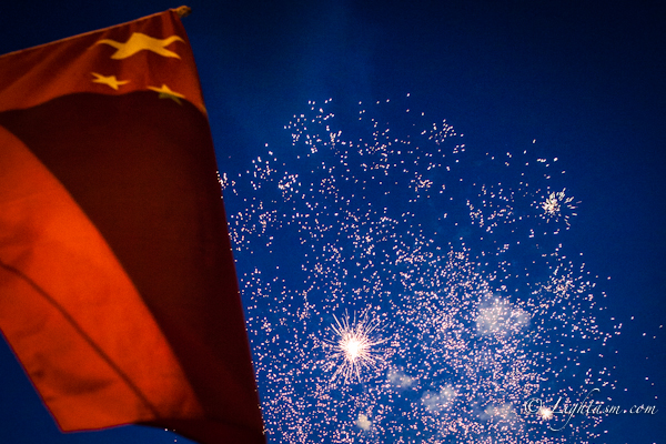 Fireworks behind Chinese Flag