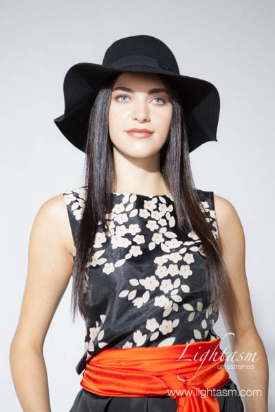 Model Wearing Hat in Fashion Photoshoot