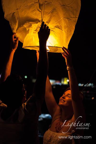 Women Releasing a Chinese Lantern
